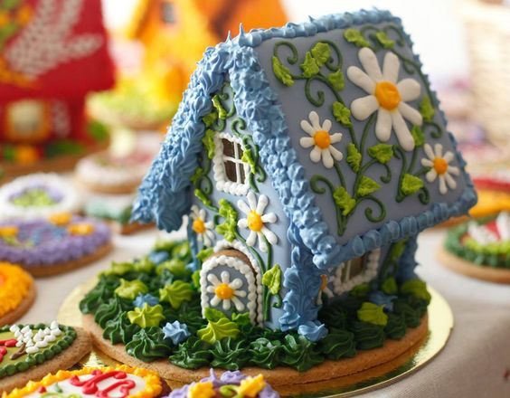 blue frosting floral themes gingerbread house.